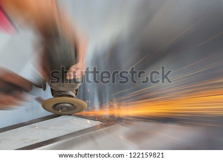 machine for grinding metal and sparks spreading - stock photo