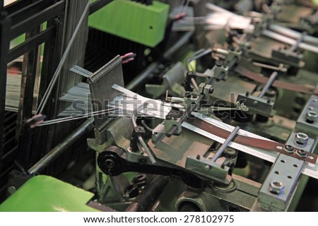 Machine for knitting textile tape on two lines - stock photo