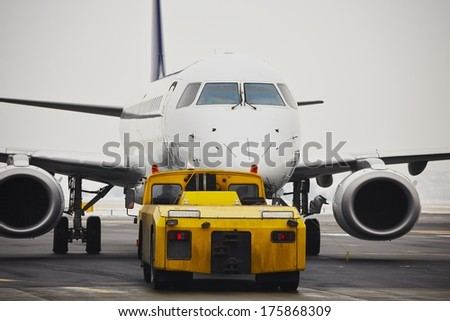 Machine for push back of the aircraft to taxiway. - stock photo