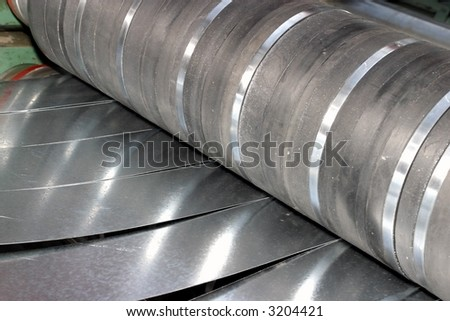 machine for slitting/cutting/stripping steel sheet - stock photo