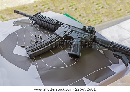 machine gun over training silhouette target - stock photo