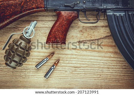 Machine gun with bullets and grenade - stock photo