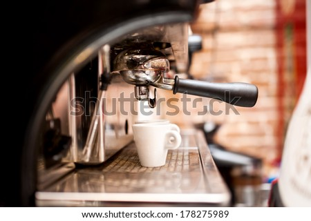 machine preparing espresso in coffee shop or bar - stock photo