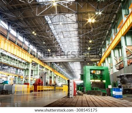 Machine shop of metallurgical works indoors room - stock photo