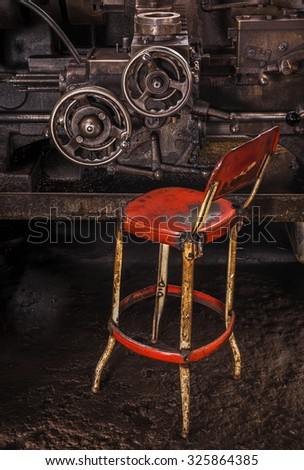 Machine Shop Red Chair - stock photo