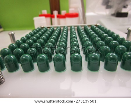 Machine to produce capsules at the pharmacy - stock photo