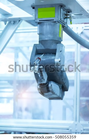 machine with robot in factory
