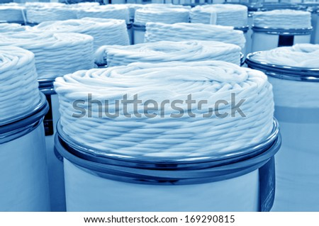 Machinery and equipment in a spinning production company - stock photo