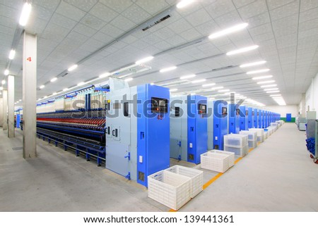 Machinery and equipment in a spinning production line in a spinning company - stock photo