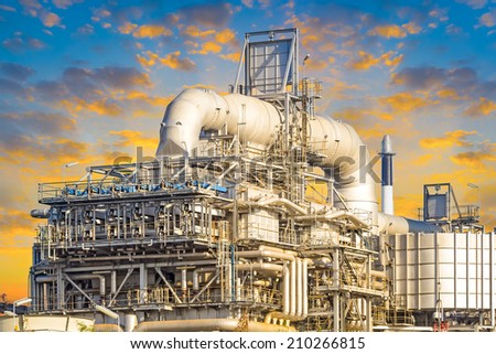 Machinery in Oil refinery plant with blue sky background. - stock photo