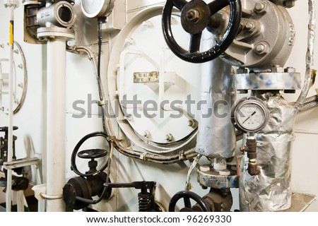 Machinery Space in Engine Room on board Huge Cargo Ship. No logos on the picture - stock photo