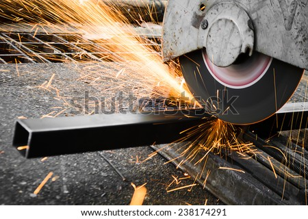 Machines for metal cutting with sparks light - stock photo