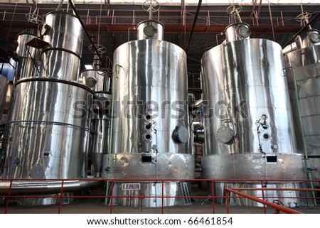 Machines inside a sugar mill - stock photo