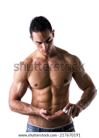 Macho male model putting shaving cream in his hand on white background