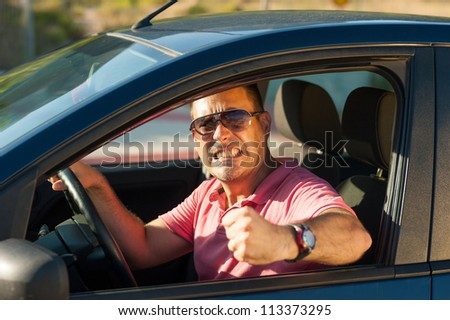 Macho type of driver about to lose it - stock photo