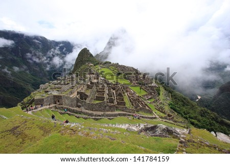Machu Picchu archaeological site of pre-Columbian civilization of the Incas abandoned only city on the Andes cordillera mountains archeology peru lima - stock photo