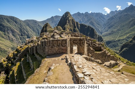 Machu Picchu entrance gate in the ruined city - stock photo