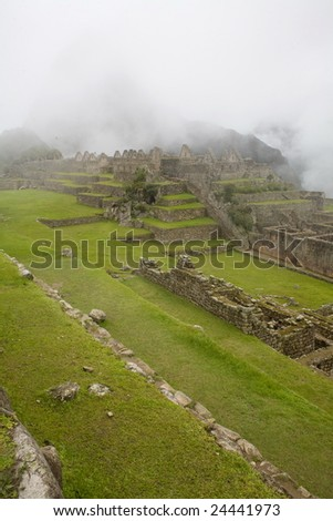 Machu Picchu is a pre-Columbian Inca site located 2,430 metres (8,000 ft) above sea level. - stock photo