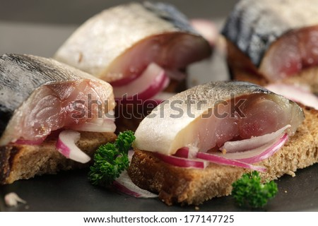 Mackerel sandwiches/ tapas  with red onion  - stock photo
