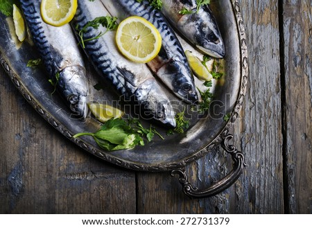 Mackerels served on silver plate with lemon