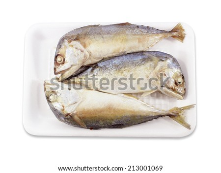 Mackerels steamed in a pack on white background - stock photo