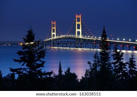 Mackinac Bridge under moonlight taken from Straits State Park.  - stock photo