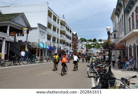 MACKINAC ISLAND, MI, USA- JUNE 21: Bicyclist ride in downtown Mackinac Island, MI on June 21, 2014. No powered automobiles are allowed on the island.