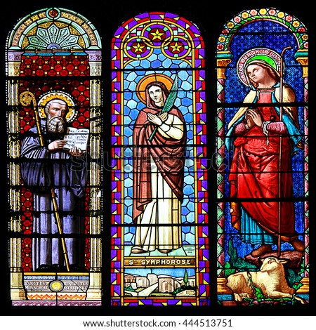 MACON, FRANCE - January 13, 2015: Stained glass window illustrated Bible stories in the Cathedral of Macon, Borgogne, France - stock photo