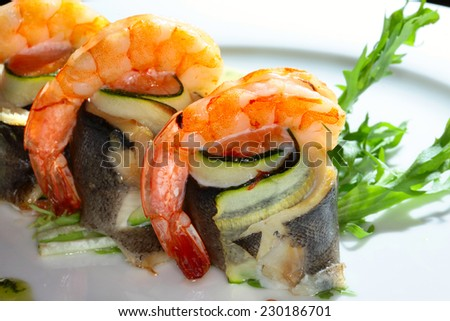 macro a second dish of fish and shrimp with creamy sauce, herbs and vegetables on a white plate on a black background studio
