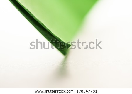 Macro, abstract, background picture of a green paper on paper background