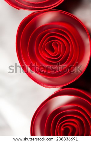 Macro, abstract, background picture of red paper spirals with reflections