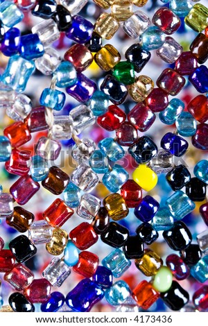 Macro African jewelry handmade , many colorful beads sewed together, - stock photo