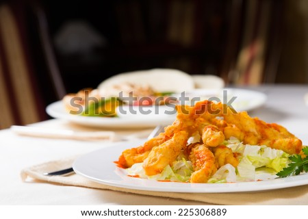Macro Appetizing Fish Meat Main Course on Table During Dinner. - stock photo