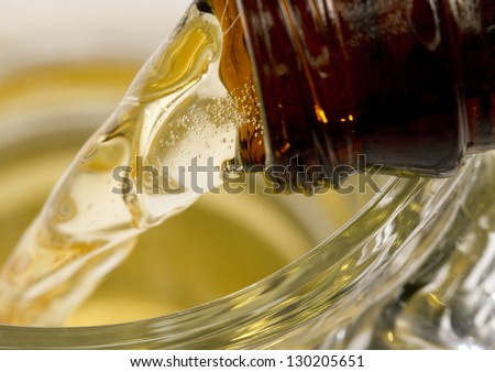 Macro Beer Pour close up macro shot of a bottled beer poured into a beer stein. - stock photo