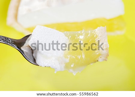 macro bite of lemon meringue pie - stock photo