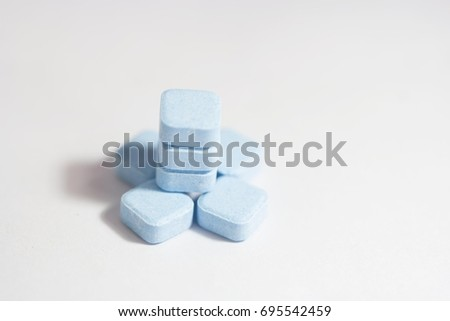 Macro  blue tablets on white (pill, blue, pills)