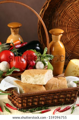 macro bread and vegetables in wicker baskets