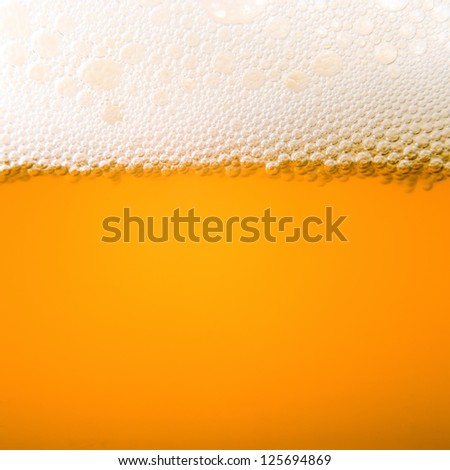 Macro bubbles of beer froth - stock photo