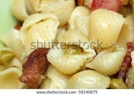 macro close up bacon and mini shell pasta with creamy pea sauce - stock photo