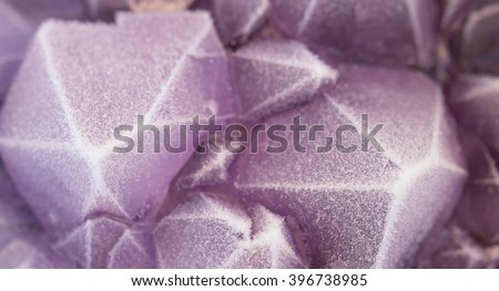 macro close up of amethyst crystal with frost  - stock photo
