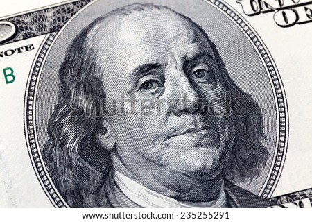 Macro close up of Benjamin Franklin's face on the US $100 dollar bill