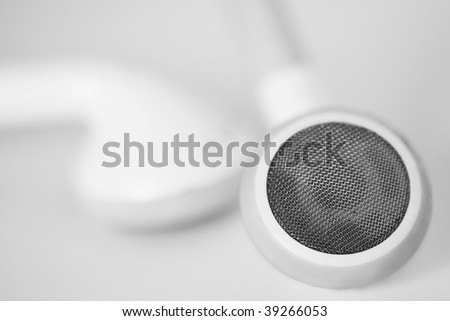 Macro close up of white headphones on a clean white background - stock photo