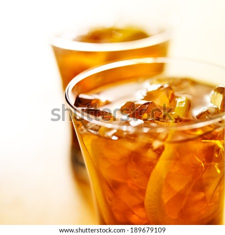 macro close up photo of a glass of iced tea - stock photo