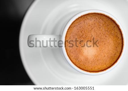 Macro close up studio shot of a cup of espresso coffee - stock photo