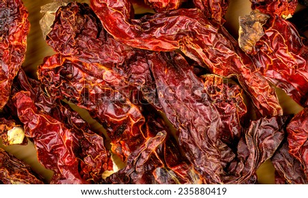 Macro closeup background texture of dehydrated red kashmiri chili - stock photo