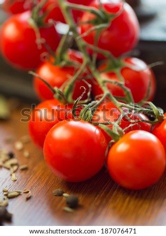 Macro closeup fresh cherry tomatoes on a wooden background - stock photo