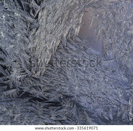 Macro, closeup of a frosty, icy glass window. Beautiful texture, pattern on a winter window after a cold night. Crystals all over. - stock photo