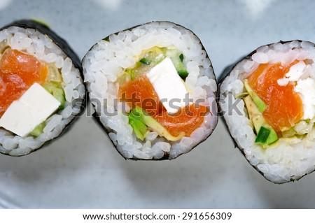 macro closeup of fresh sushi choice combination assortment selection  - stock photo