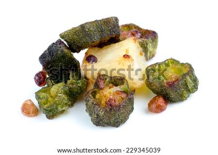Macro closeup of fried okra with cumin and potato isolated on white - stock photo
