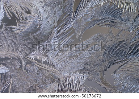 macro closeup of frost formations on a frozen window. - stock photo